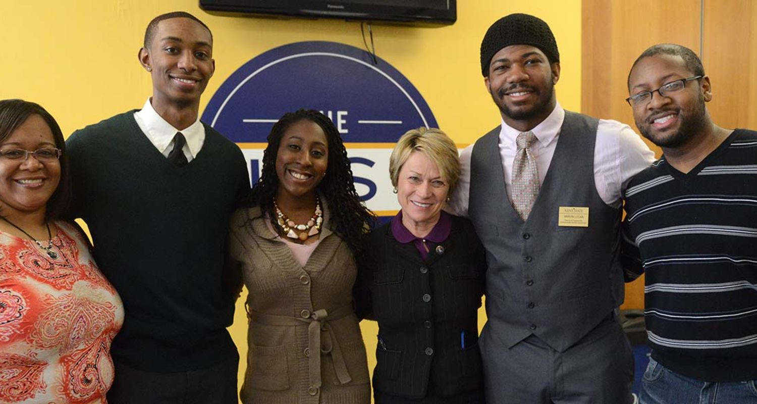 Dr. Warren poses with students at The Nest.