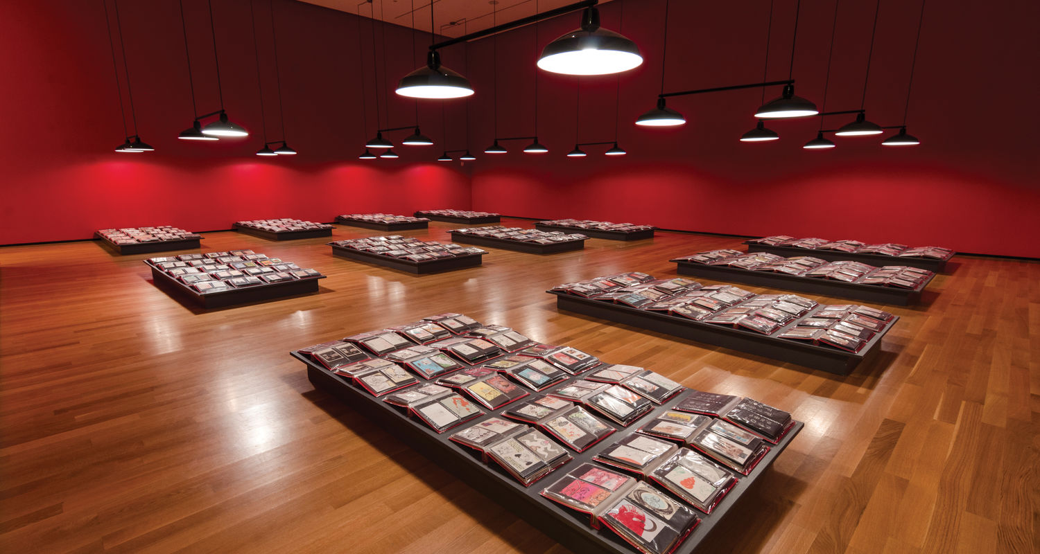 """Curator Adam Lerner refers to the more than 30,000 postcard-size drawings, prints and collages that Mothersbaugh has made for the past 40 years—all on view at the Akron Art Museum—as """"the archive of Mark's brain."""" Photo: Joe Levak"""