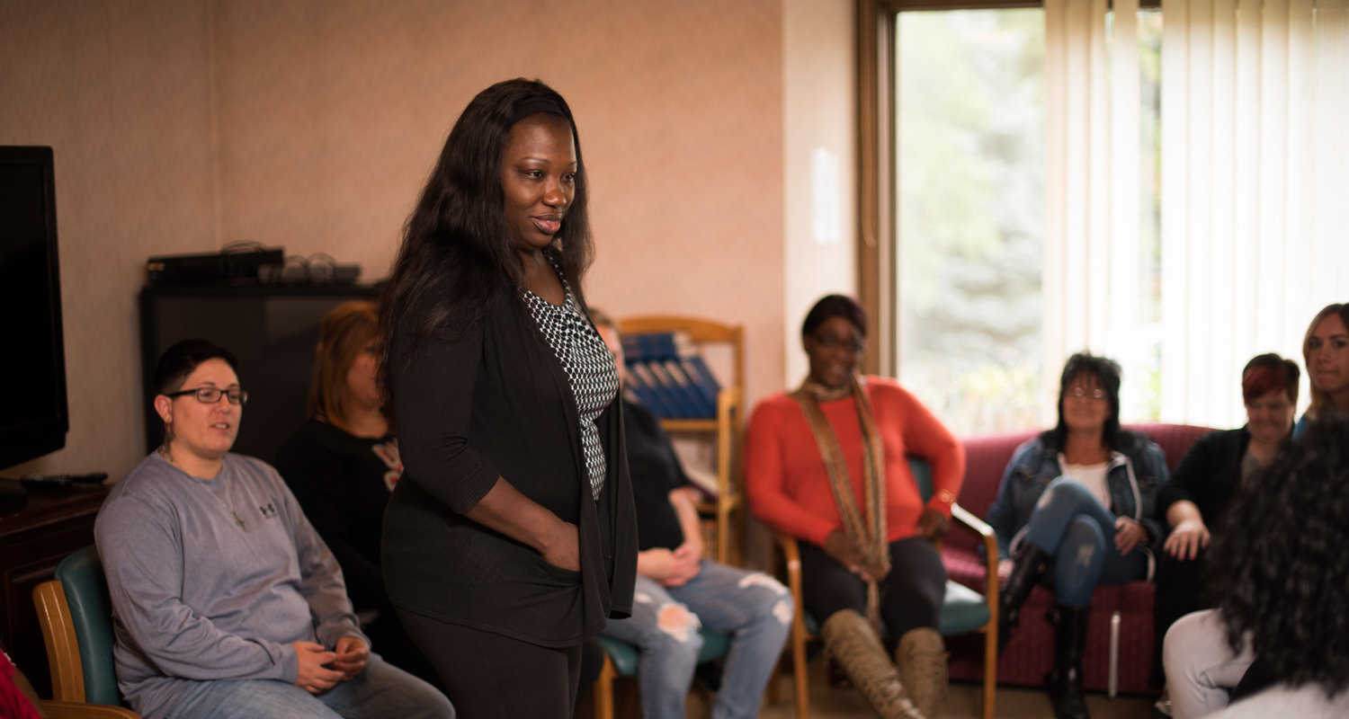 Anita Bradley talks with women gathered in the living room of a NORA residential treatment center in Cleveland Heights. During the 90-day program, they meet daily to discuss the challenges they face in recovery.