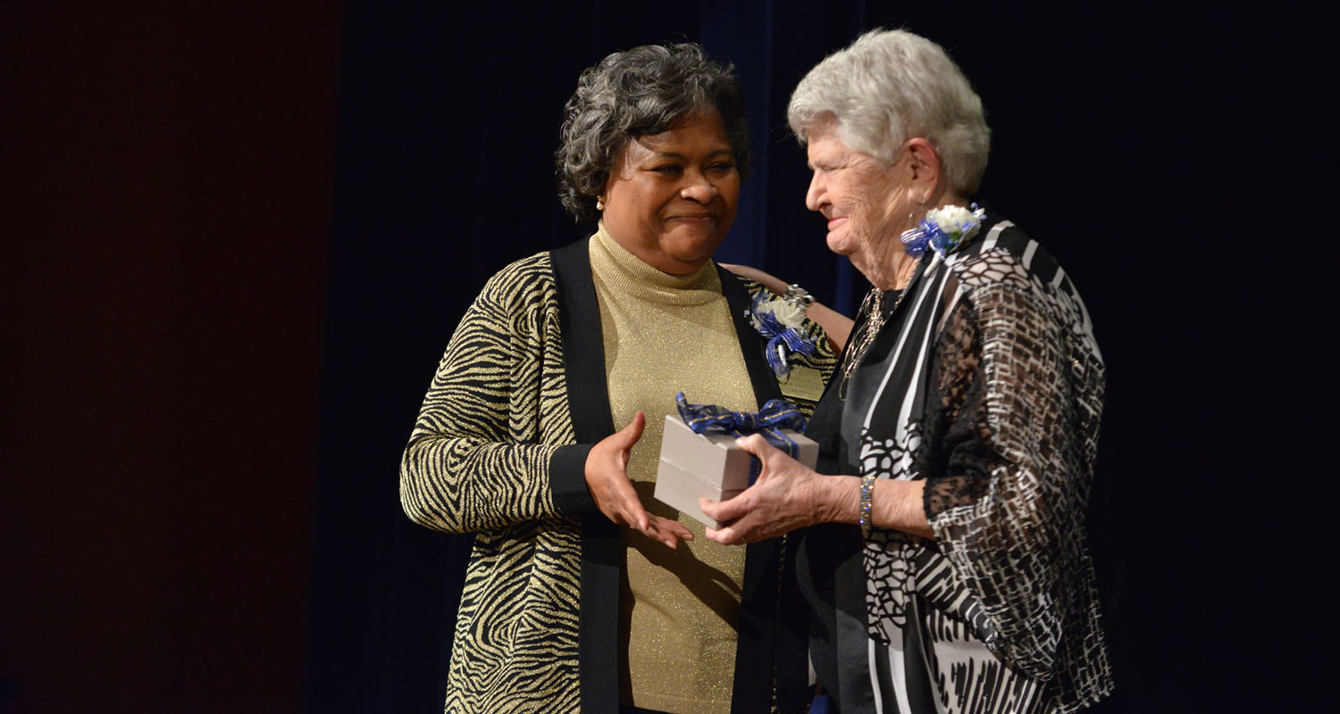 Dean Barbara Broome gives a gift to Barbara Donaho as a token of appreciation for her contributions.