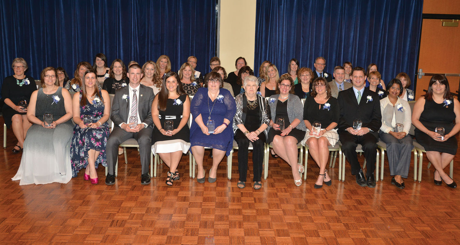 Barbara Donaho, front center, sits with the 2016 recipients of the Barbara Donaho Distinguished Leadership in Learning Award.