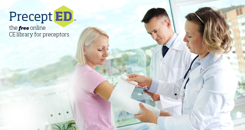 A preceptor helps a student complete a procedure