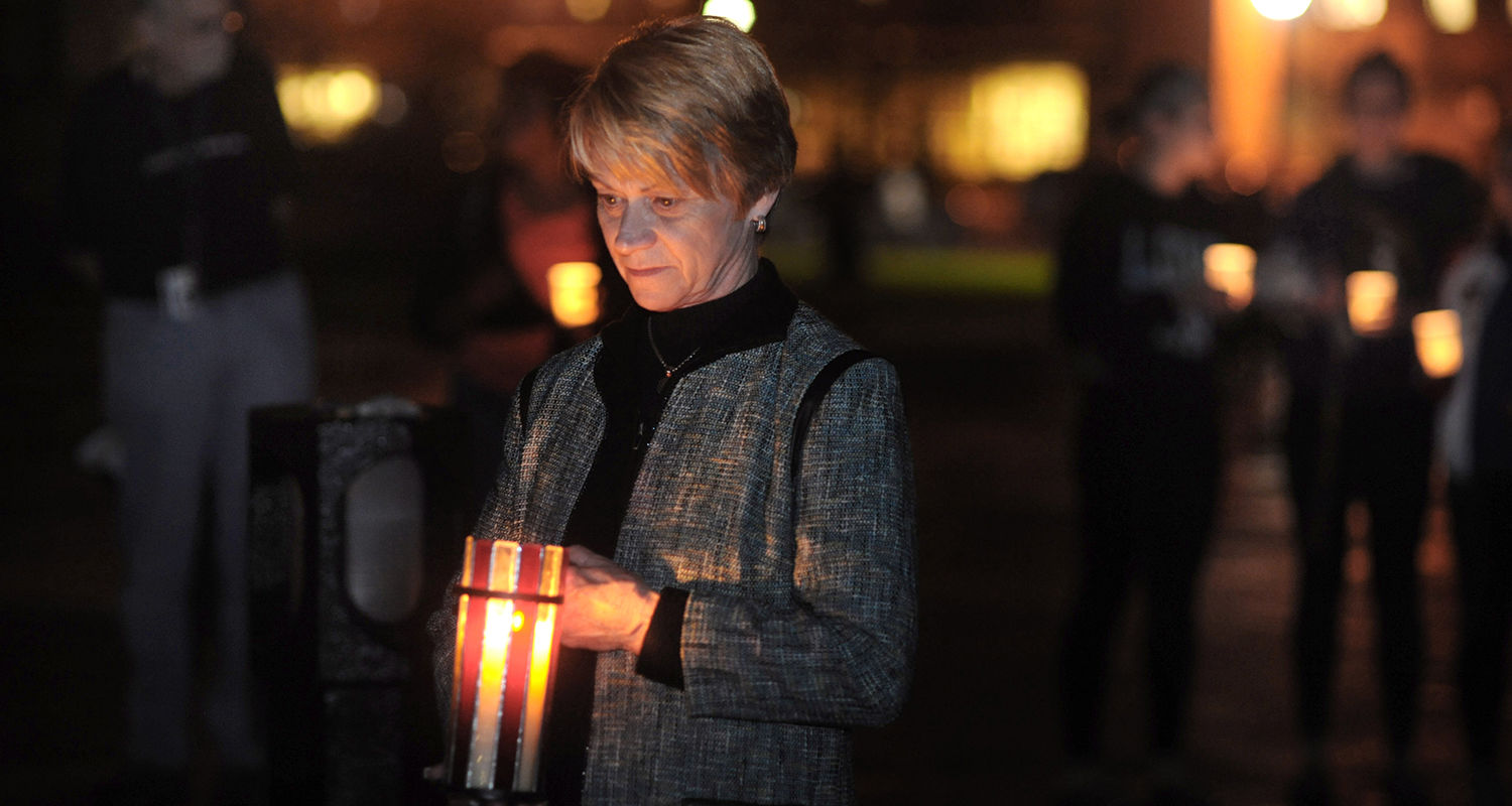 Kent State President Beverly Warren stands vigil on the spot where Allison Krause was shot during the May 4, 1970, shootings.
