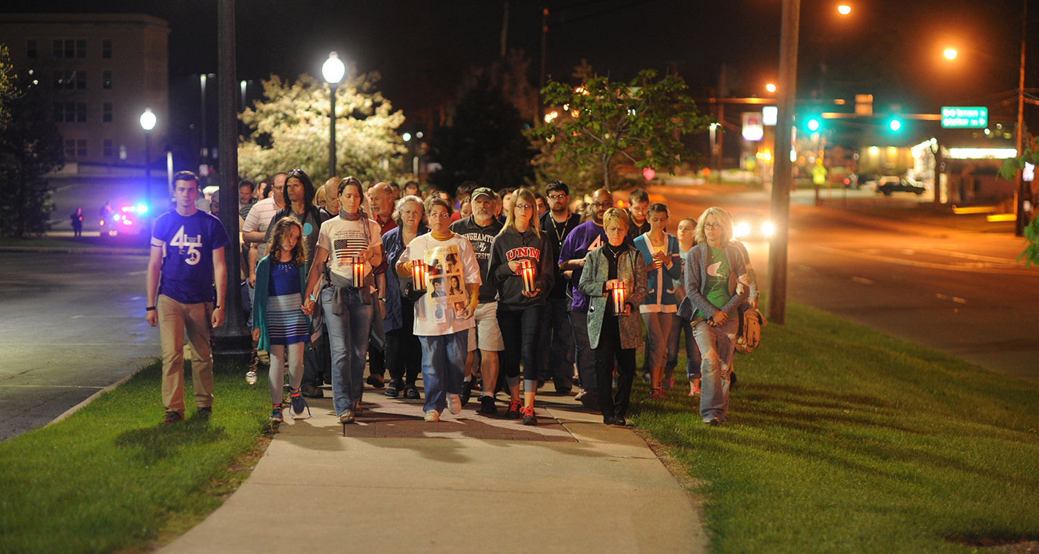 Members of the Kent State community, including Kent State President Beverly Warren, participate in the candlelight vigil march around campus to commemorate the 45th anniversary of the May 4, 1970, shootings.