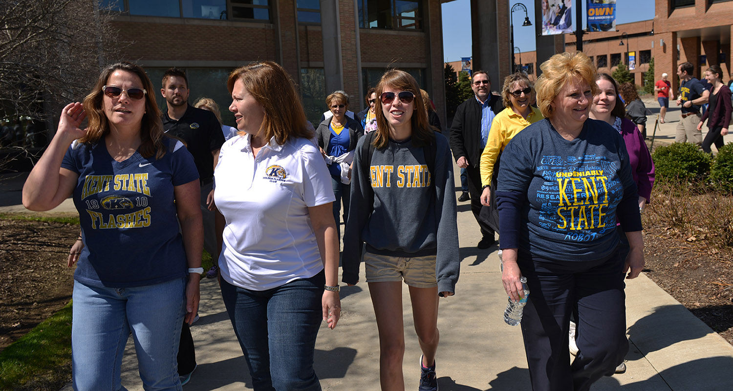 Kent State University employees, led by a Kent State zoology major, explore campus pollinators during a lunchtime walk and talk on the Kent Campus.