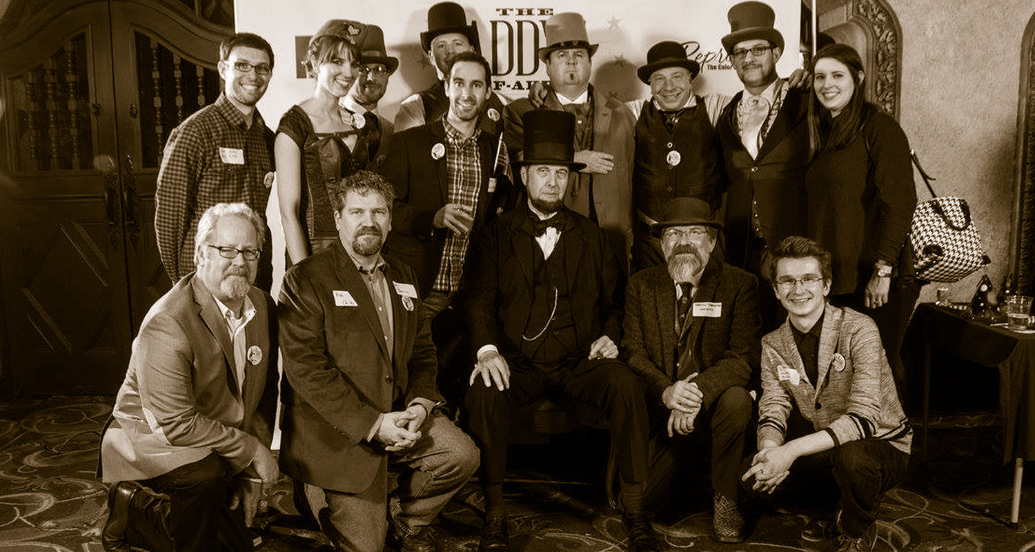 Kent State's University Communications and Marketing staff, pictured, selected an Abraham Lincoln theme and created marketing materials for the 2016 American Advertising Federation of Akron's ADDY award ceremony.