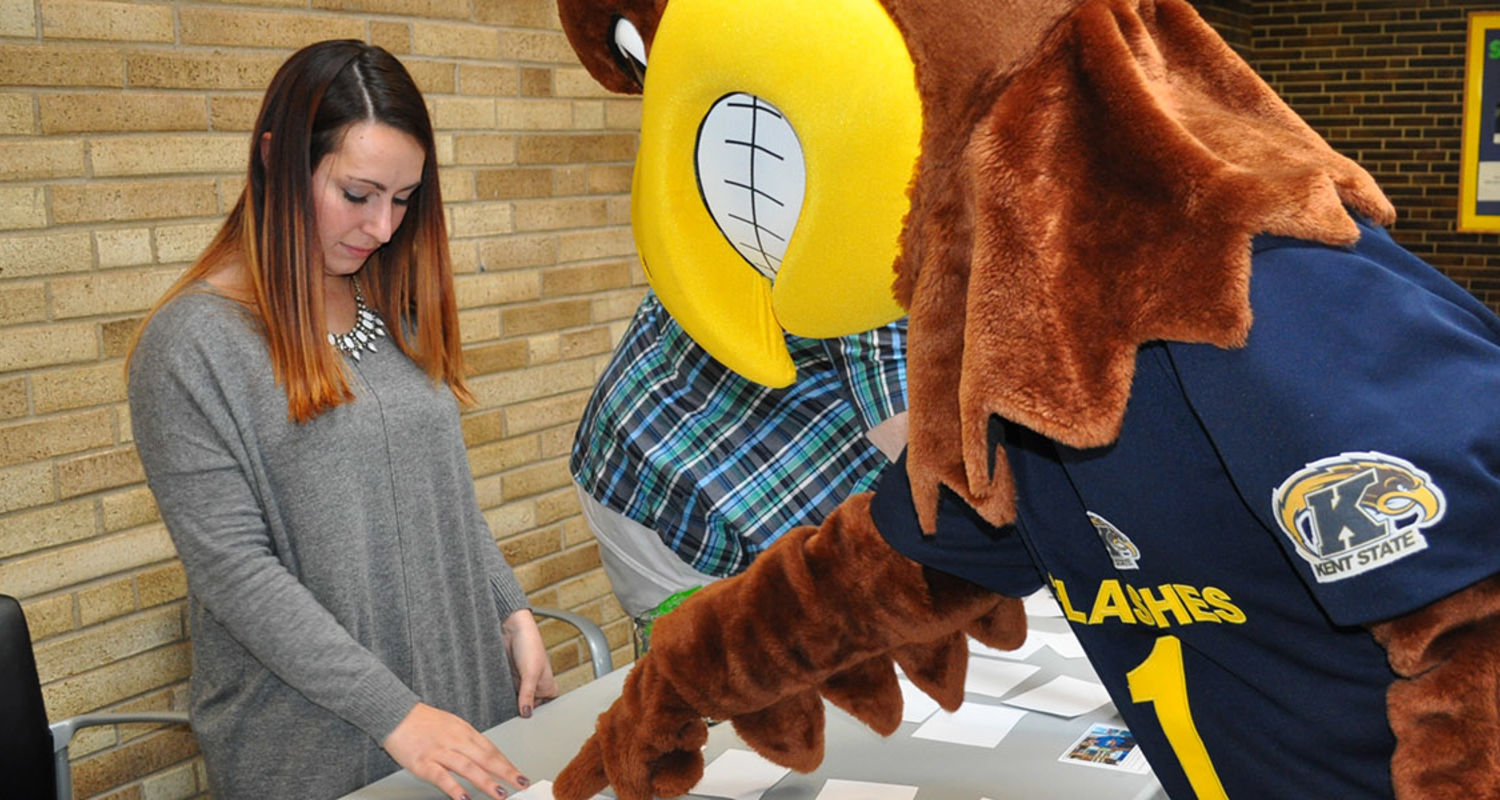 """Kent State University mascot Flash helps to motivate students in Sarah Smiley's class during a class project. Smiley modeled her class after """"The Amazing Race."""""""