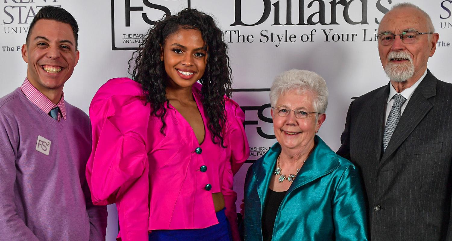 students posing with donors at annual fashion show
