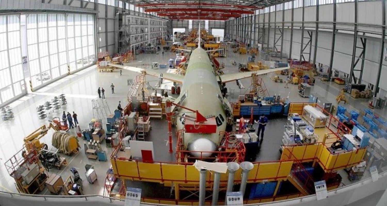 photo, international, plane inside hangar for maintenance
