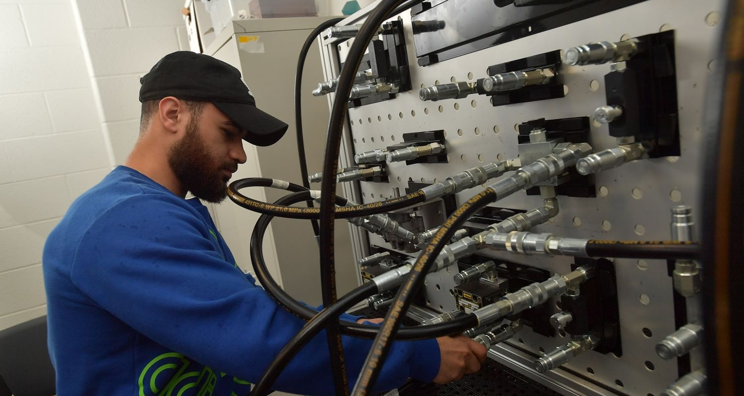photo student working in hydraulics lab