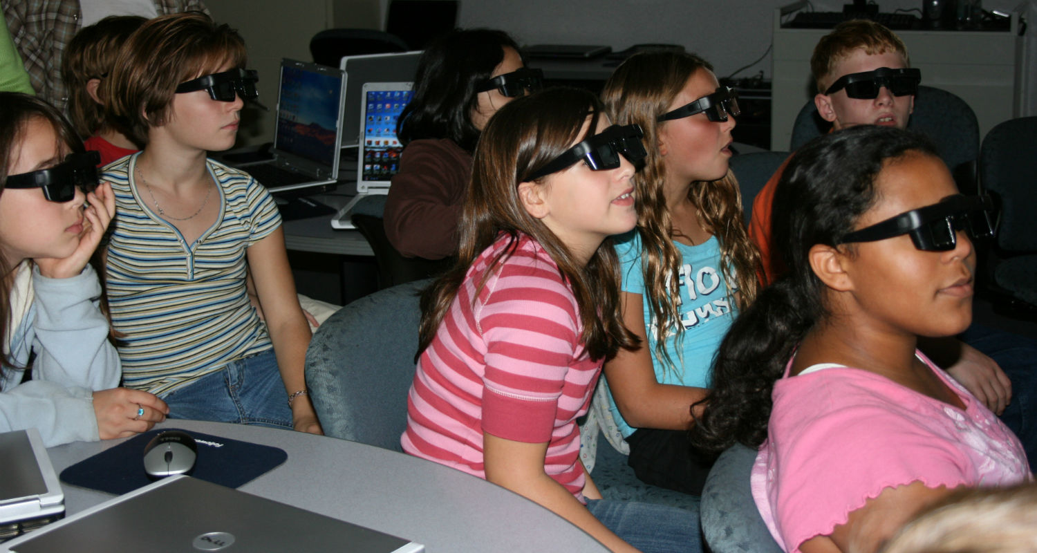 Students wearing glasses to view 3D imagery