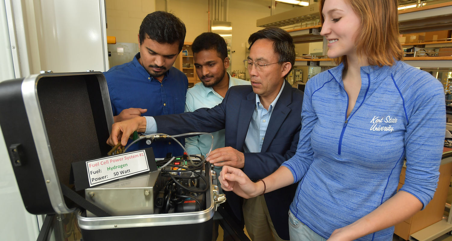 SURE Fellow Angela Deibel works on a fuel cell model with Dr. Yanhai Du and her labmates, grad students Sriram Matturi and Chaitran Chakilam.