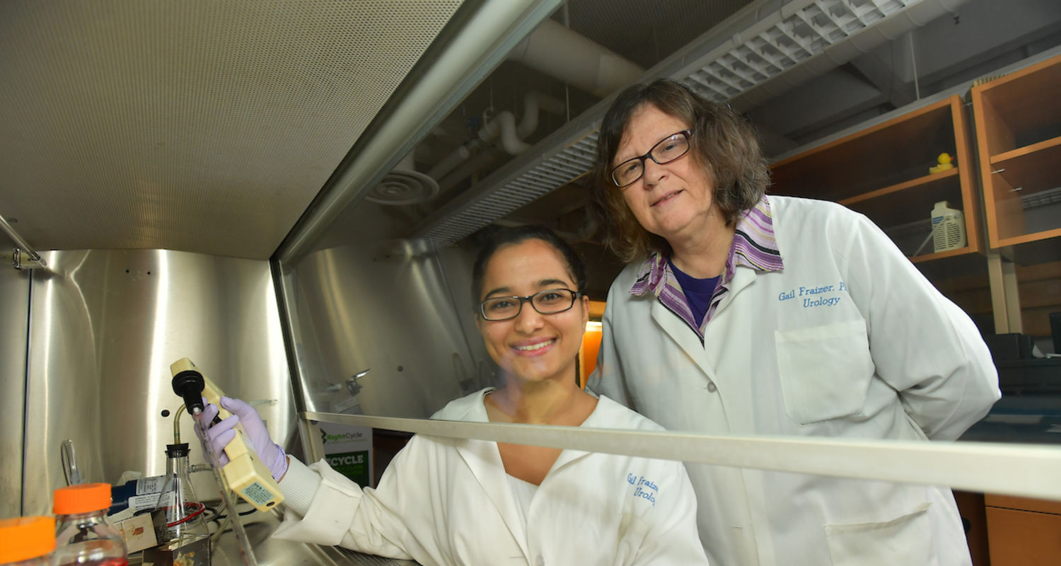SURE Fellow Nirmala Ghimirey sits in a lab with her mentor, Prof. Gail Fraizier