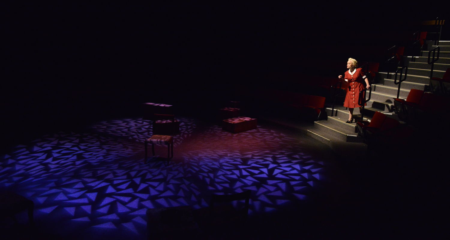"""An element of the lighting design of student Sophia Phillips is displayed on stage during """"Irena's Vow."""""""