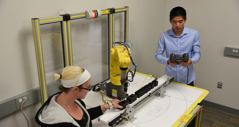 New FANUC robot with conveyor