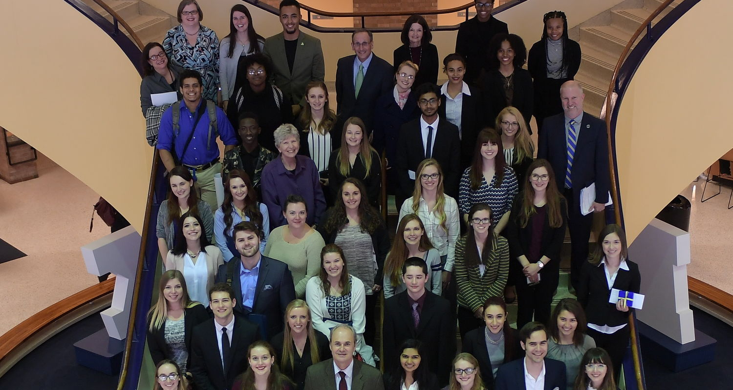 Kent State undergraduates pose with University officials following award presentations at the 2017 Undergraduate Research Symposium