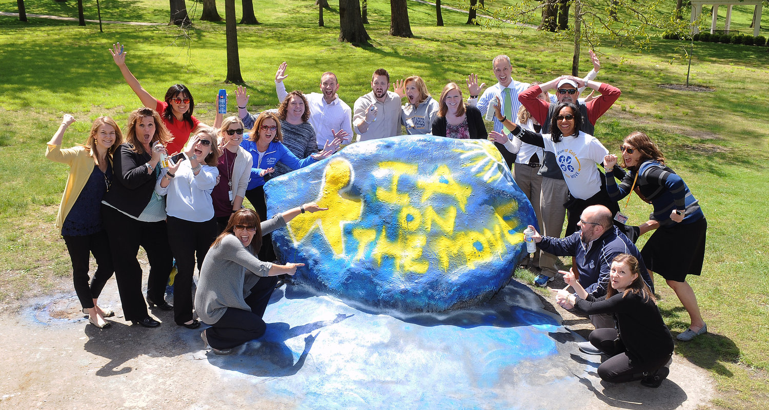 Employees in Institutional Advancement paint the Kent State rock