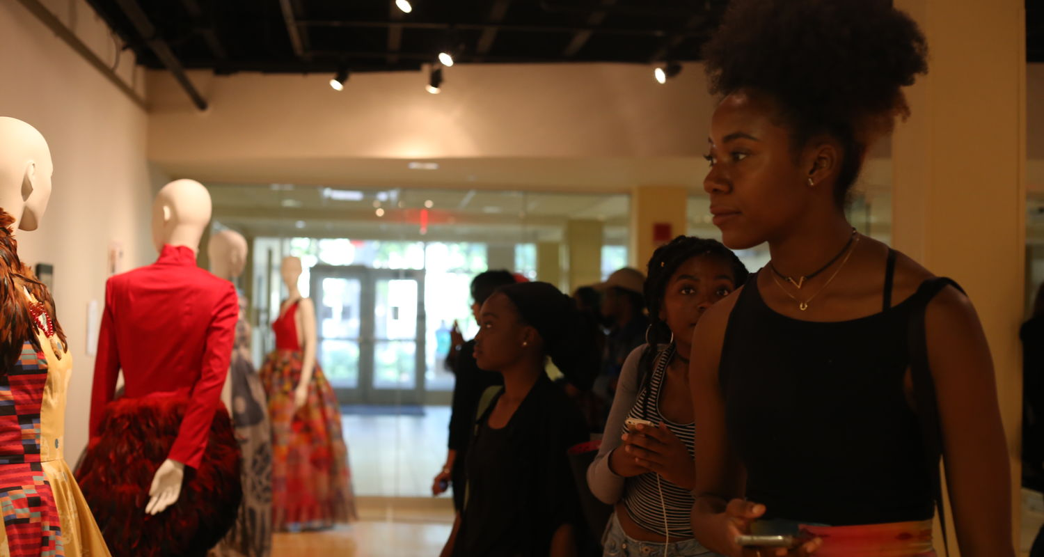 Students view Retold exhibit in Uumbaji gallery
