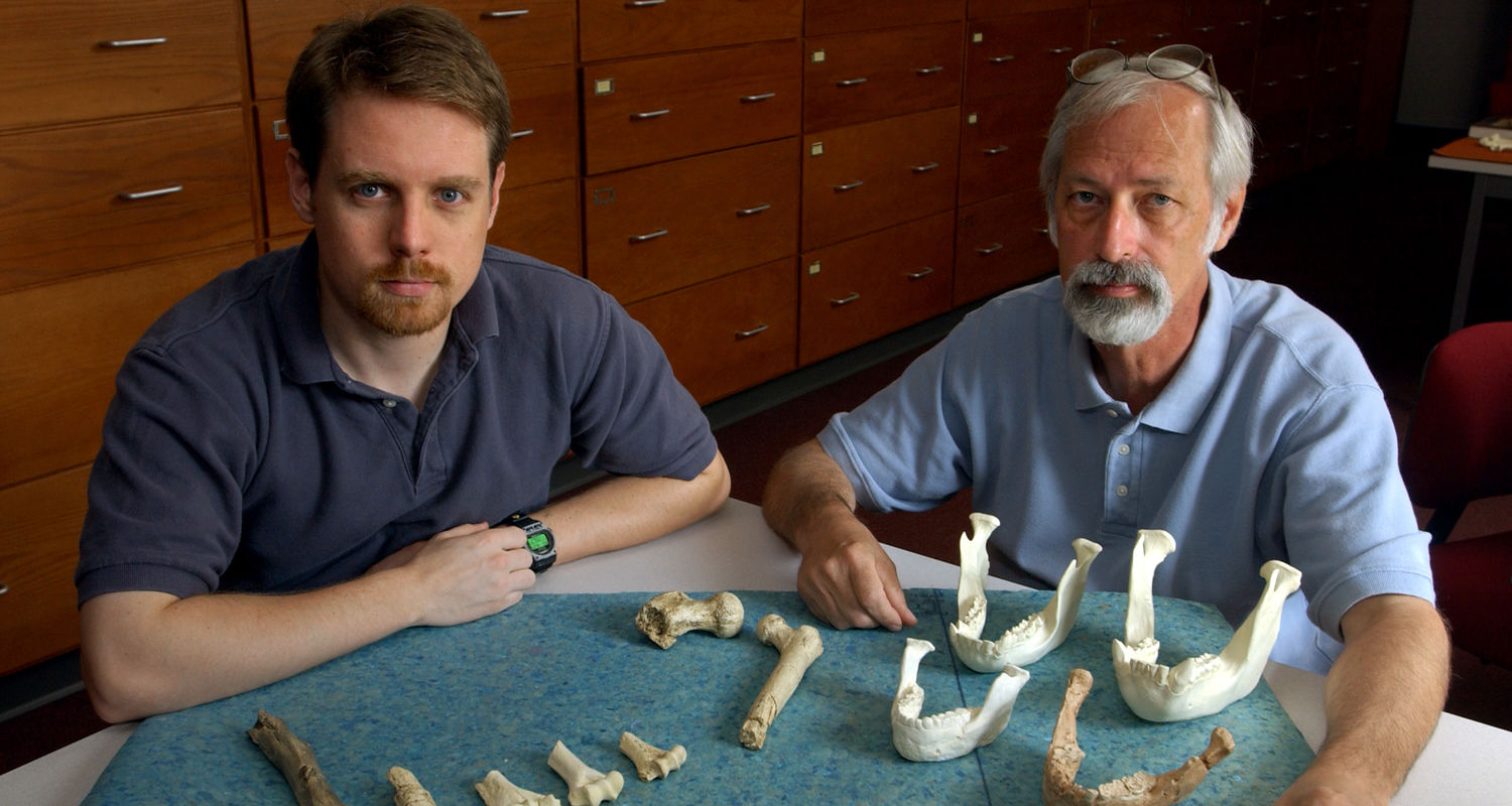 Ph.D. student Phil Reno and Professor Owen Lovejoy pose with some material used for Reno's recent research into the monogamy in early humanids. Included are the bones from Lucy and other specimens.