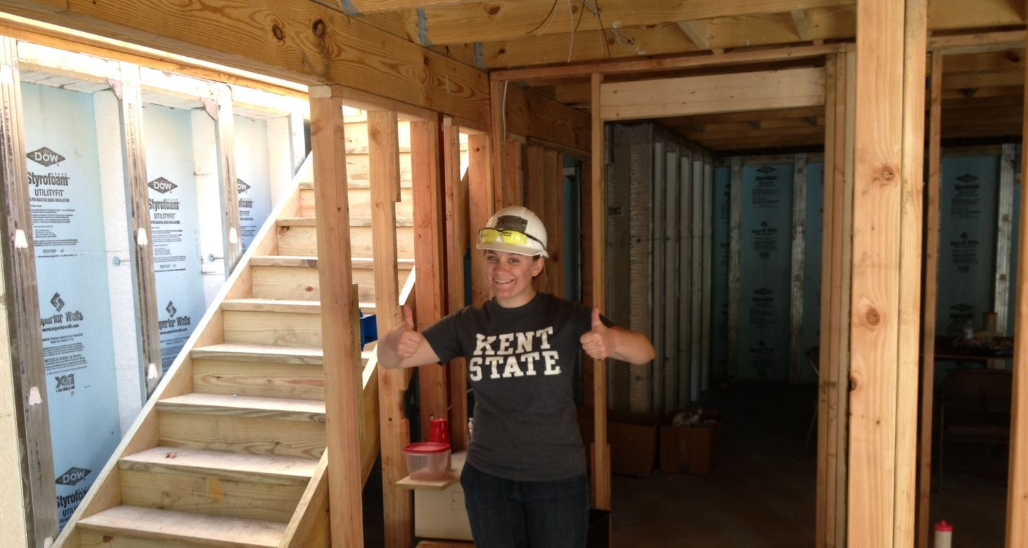 Construction Management student on site indicating thumbs up