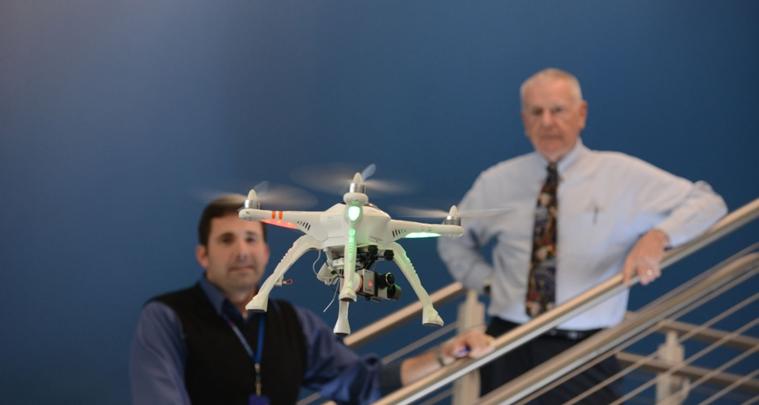 Dean and Dr. Stringer watch UAV
