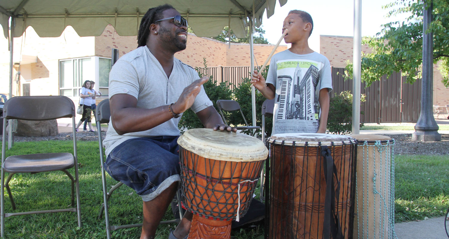 Olu Manns plays the drums at a department cookout.