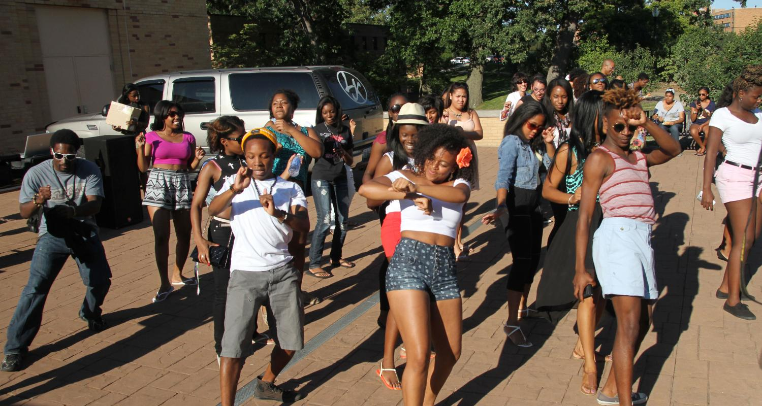 Students dance at a department cookout.
