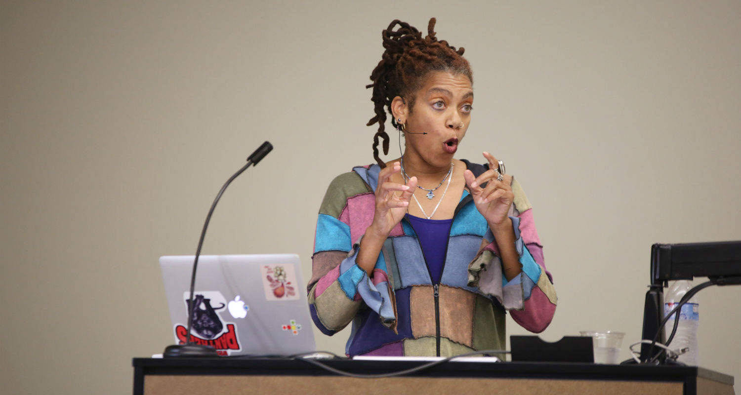 Dr. Rhonda Y. Williams, an associate professor of history at Case Western Reserve University, delivers a keynote speech for the Race on Trial Symposium.
