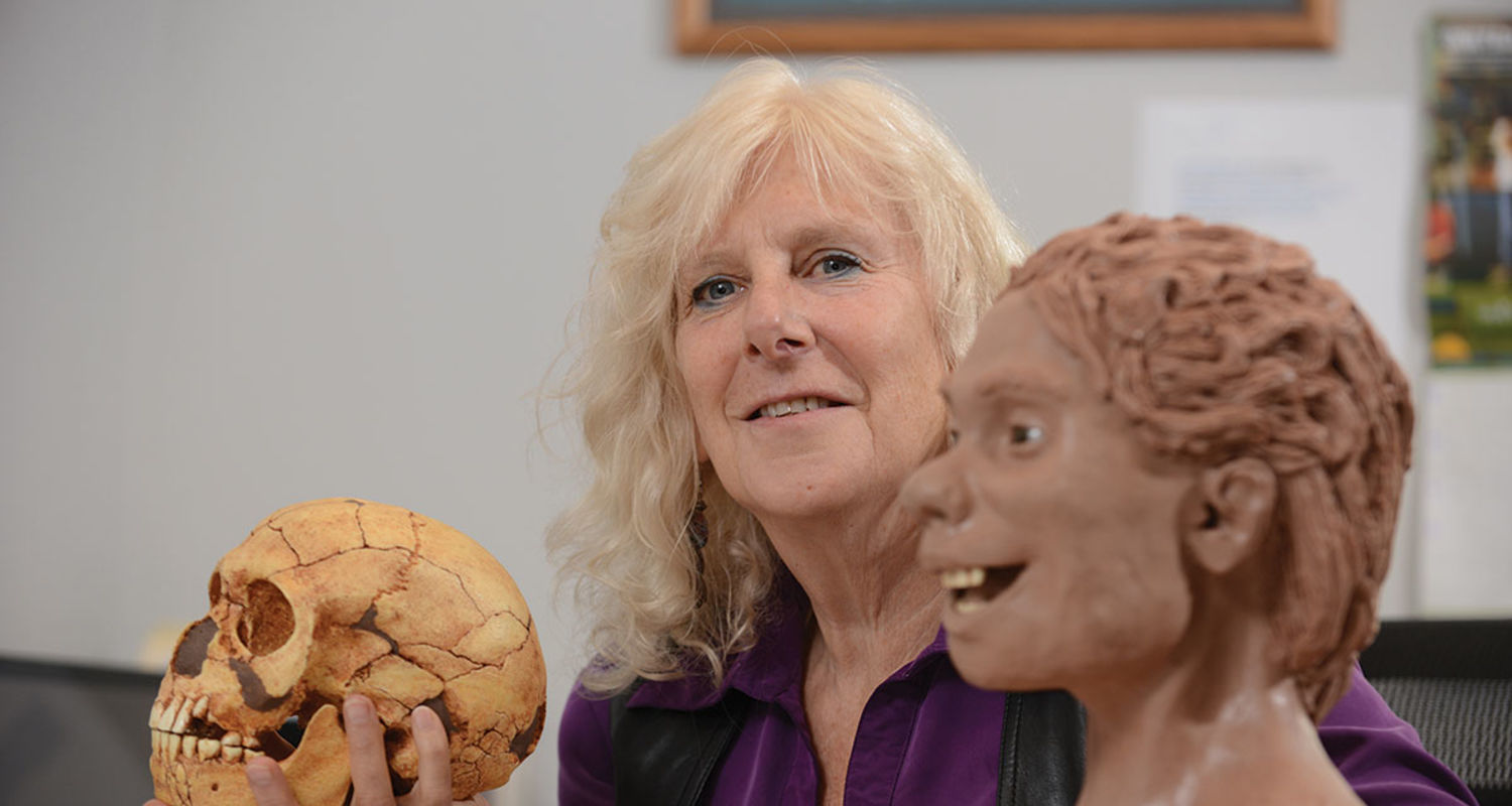 Doctor Linda Spurlock holding a model of a human skull in her hand