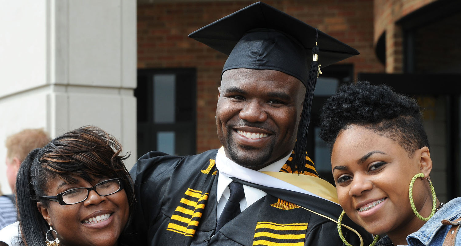 A spring 2010 graduate celebrates with his family following commencement ceremonies.