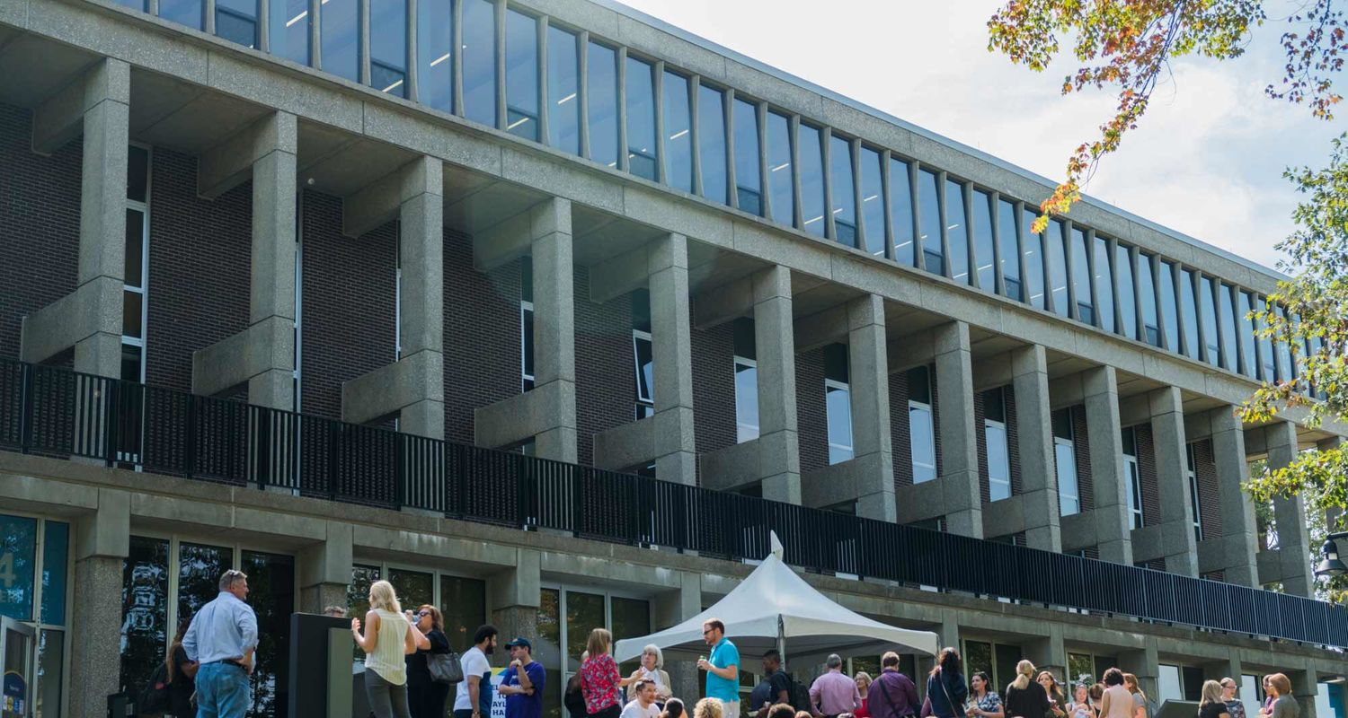 Students gather outside of Taylor Hall during its grand reopening