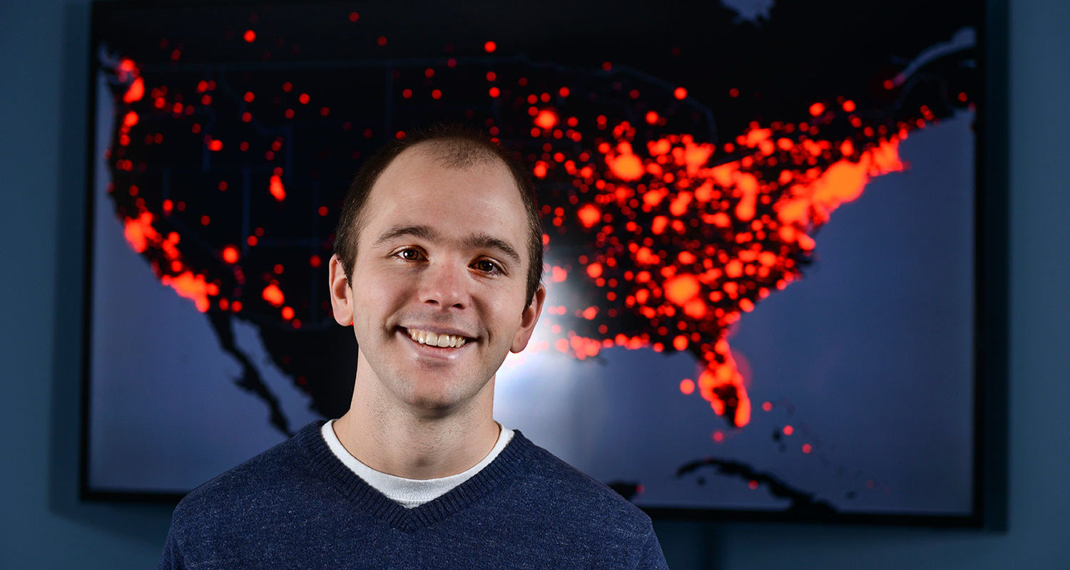 Eric Shook with a map showing all the tweets about Ebola sent in the U.S.
