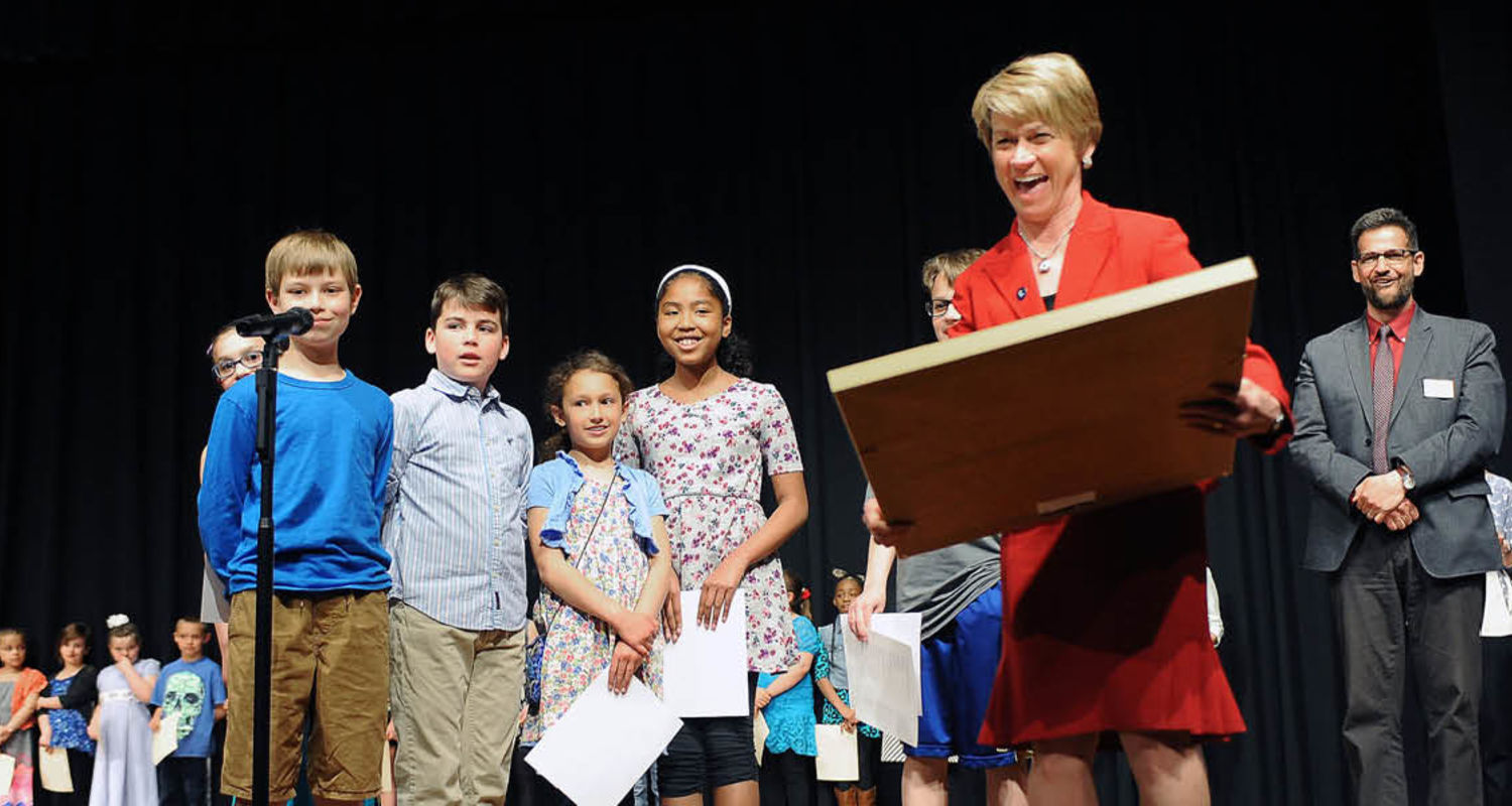 Kent State President Beverly Warren reacts to a gift presented to her by the Holden Elementary School Writer's Club during the Giving Voice program in the Kent Student Center Ballroom.