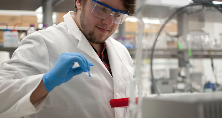 A student researcher uses as vacufuge in a research laboratory.