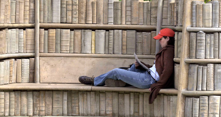 """A Senior English Major reads the Daily Kent Stater at the """"Behind the Brain Plaza"""" near Merrill Hall."""