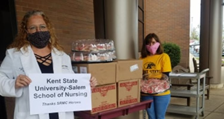 Nursing faculty member Lorene Martin (left) delivered pepperoni rolls to employees at the Salem Regional Medical Center and Danielle Baker-Rose delivered her homemade frosted sugar cookies.