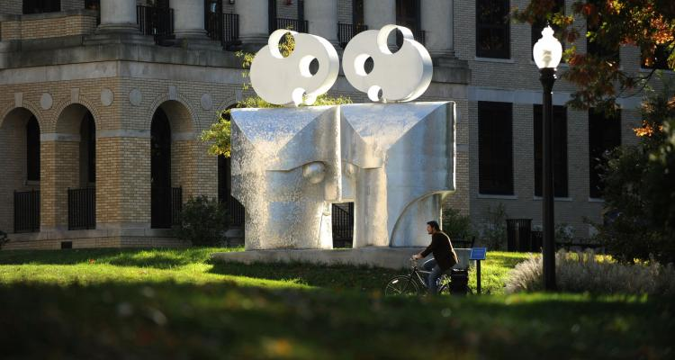 "Outside view of Kent Hall and ""Eye to Eye"" sculpture by Barry Gunderson."