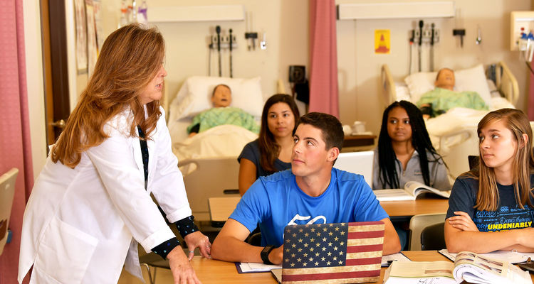 Kent State nursing students in class, listening to instructor Mary Kutchin