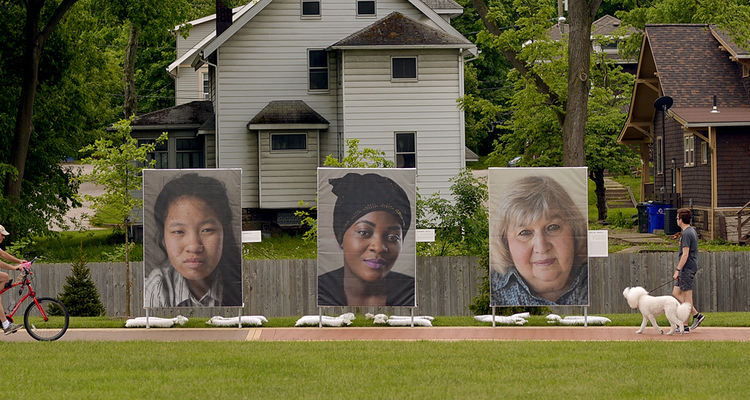We the People large scale portraits of refugees on display on Kent State Campus