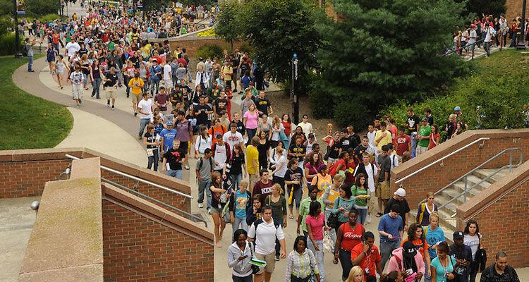 Students walk along the university esplanade