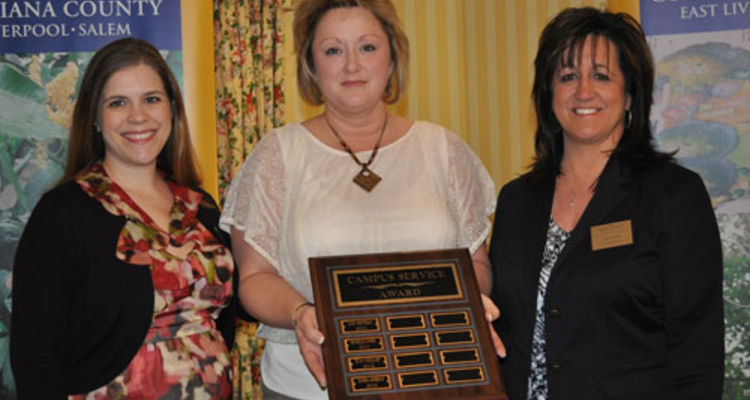 Sandi Anderson (center) received the Campus Service Award during the Kent State University at Salem's annual awards ceremony.