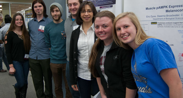 A research group at a past SAACS poster session.