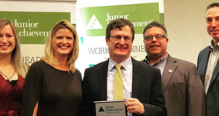 Dan Palmer, Ph.D. (center), assistant dean of academic affairs and Junior Achievement of Mahoning Valley board member, accepts the 2018 Volunteer Organization of the Year Award at Junior Achievement's annual recognition breakfast.
