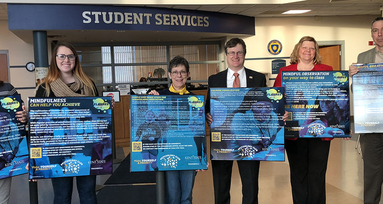 Members of the Kent State University at Trumbull community display mindfulness posters that encourages mindful breathing, observation, and/or awareness, and promotes counseling services for students in need.