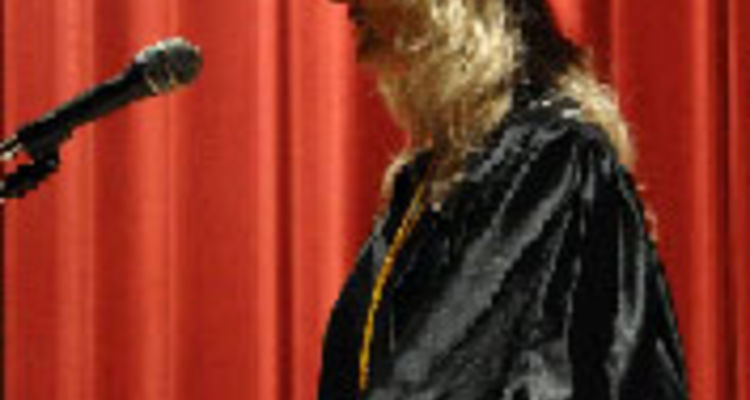 Laura O'Wesney, radiologic technology graduate, also addresses the Salem crowd.