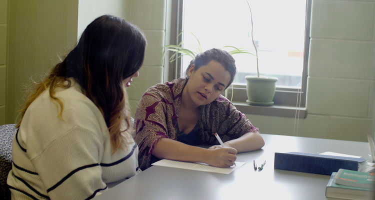 A writing tutor assists a student at Kent State's Writing Commons.