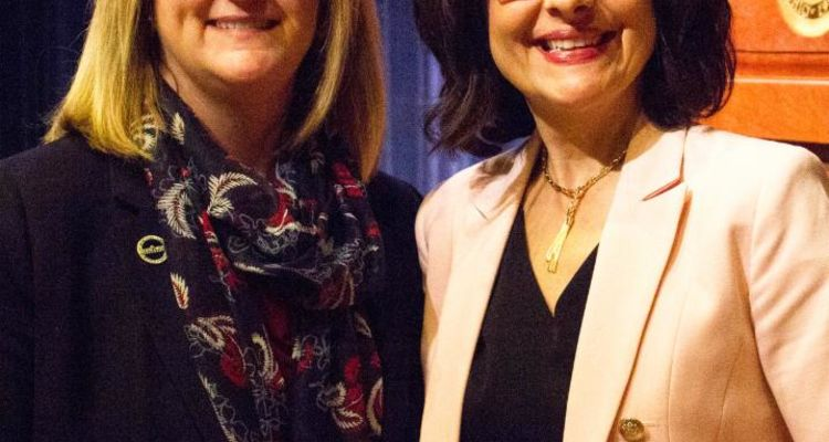 Two women stand smiling at Kent State's College of Business Administration's 2017 Spirit of Women in Business Conference.