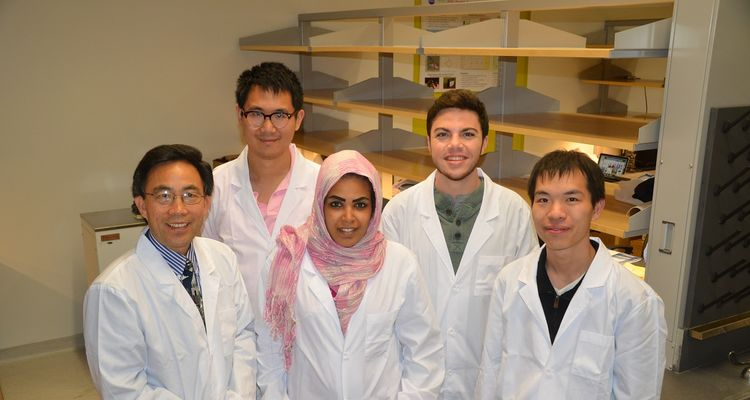 photo Fuel Cell Research Team next to open shelving 2014