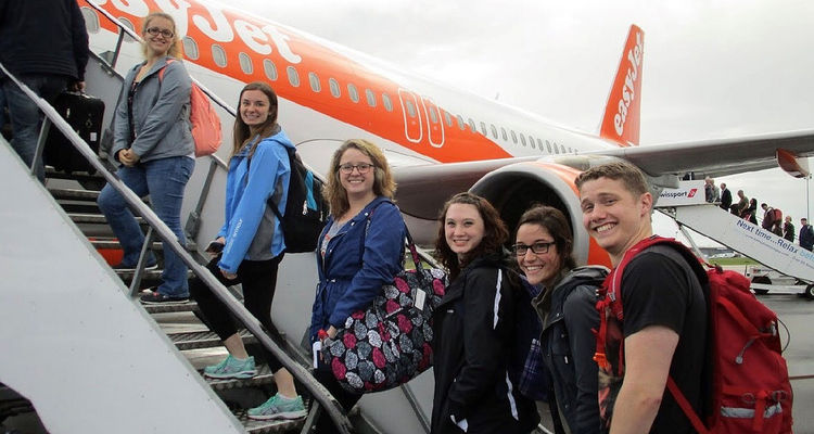 Students who were studying in Northern Ireland boarding their airplane