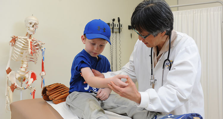An advanced practice nurse examines a young child